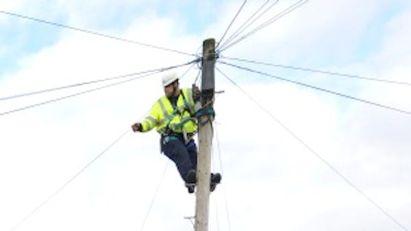 BT Openreach engineer up a pole