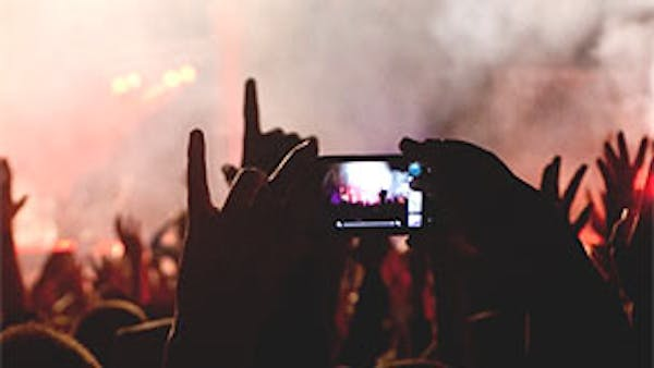 Using a smartphone at a festival