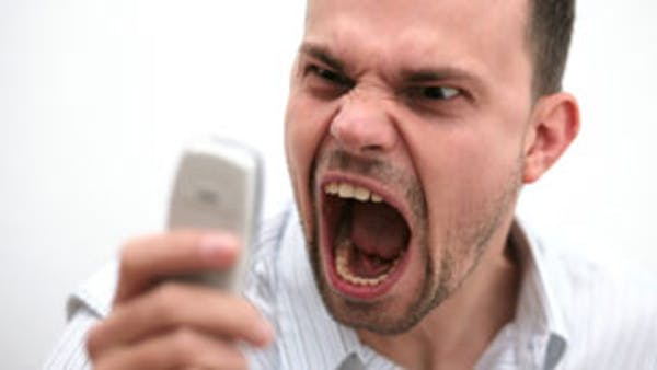 A man shouting into a phone