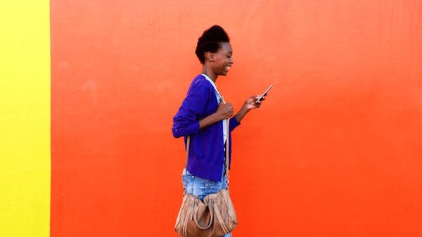 Woman walking and using a smartphone